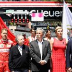 """בנגינת ההמנון, מימין לשמאל: הנסיך אלברט, אשתו, צ'ייס קארי הבוס החדש של פורמולה 1, ז'אן טוד, הבוס של הפי""""א, סבסטיאן ווטל ומקס וורסטפאן"""